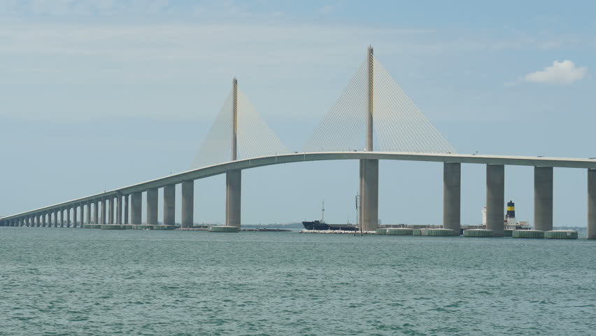 Traffic crosses the sunshine skyway bridge over tampa bay for Tampa fishing piers