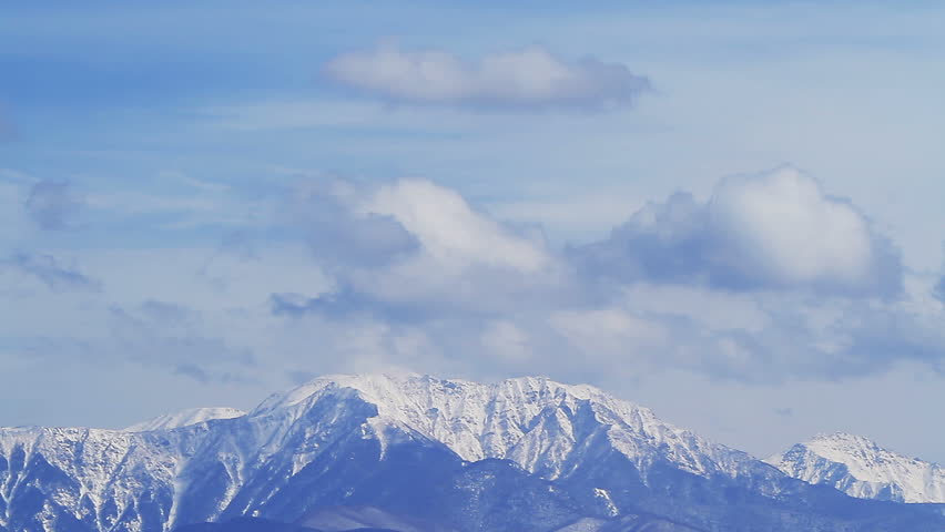 The clouds moving over the snow mountain landscape, Japan North Alps. Time Lapse. (without birds)