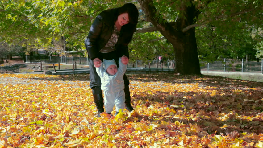 mother walking with baby  - HD stock video clip
