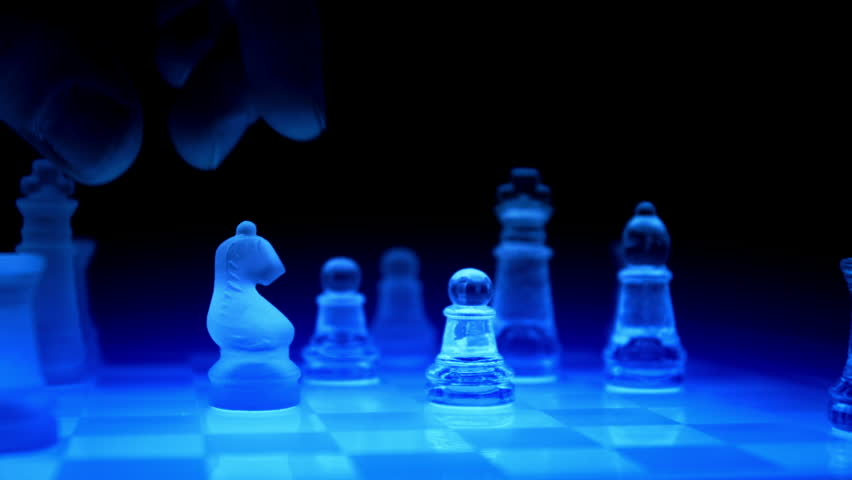 Tracking Shot Playing On A Blue Futuristic Glass Chess