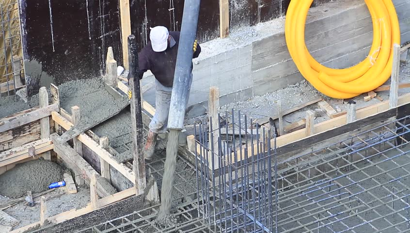 Pouring Concrete Into Reinforcing Steel Stock Footage