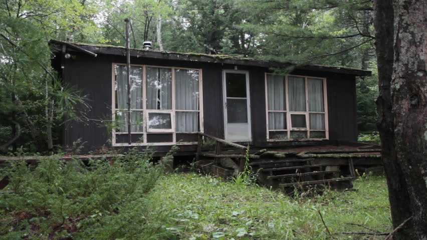 An abandoned cottage in the woods. Sound of rain falling. Three shots. Rural Ontario, Canada. - HD stock footage clip