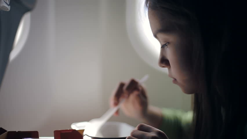 child eating in the airplane - HD stock footage clip