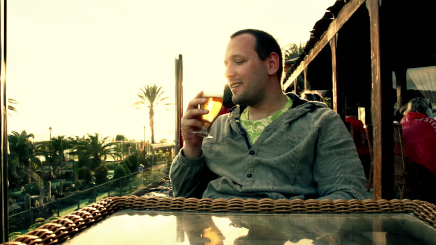 Man drinking beer, outdoors - HD stock footage clip