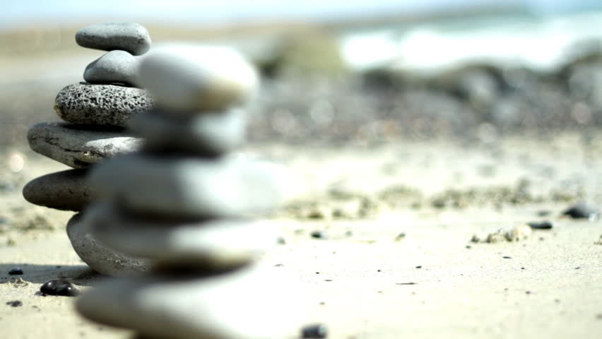 Zen stones on a beach, dolly shot - HD stock video clip