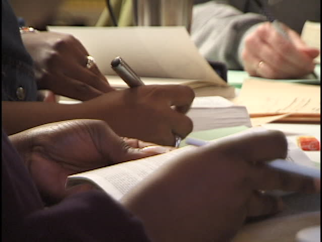 group studying at table - SD stock footage clip