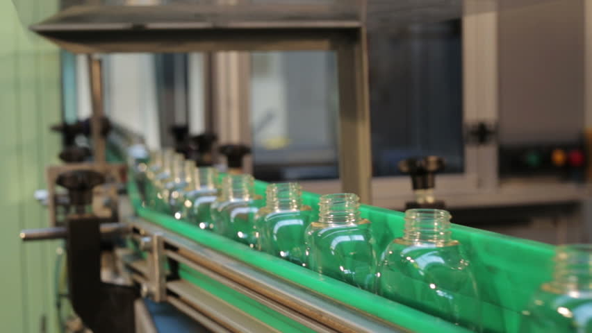 Production line. packing private label products, no name products, bottles