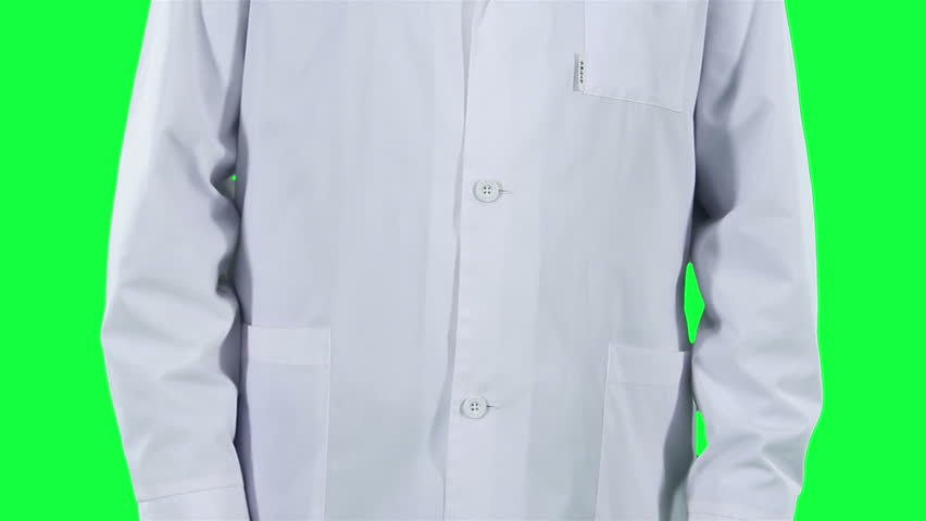 Doctor puts on gloves closeup. Chroma key background. Medic in a white coat