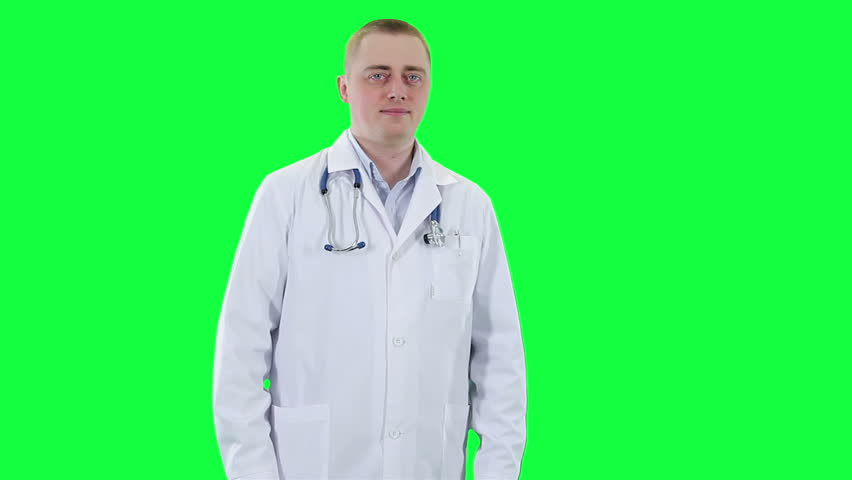 Doctor offers to take the pill. Chroma key background. Medic in a white coat holds out a cure