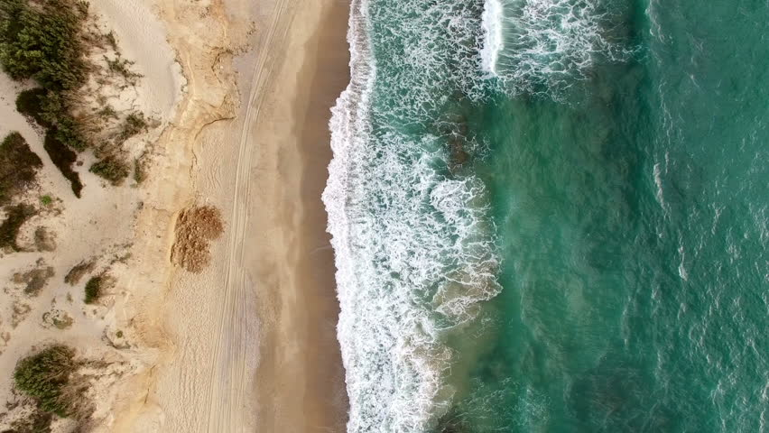 Aerial: Top shot of the coastline. Idyllic cinematic shot  Ocean sea loneliness.