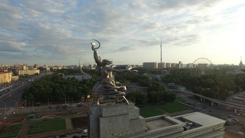 RUSSIA. MOSCOW. VDNkH. JULY 2015: Rabochiy i Kolkhoznitsa (Worker and Kolkhoz Woman) by sculptor Vera Mukhina. Sunset time. HELICOPTER VIEW 7 - 4K stock footage clip