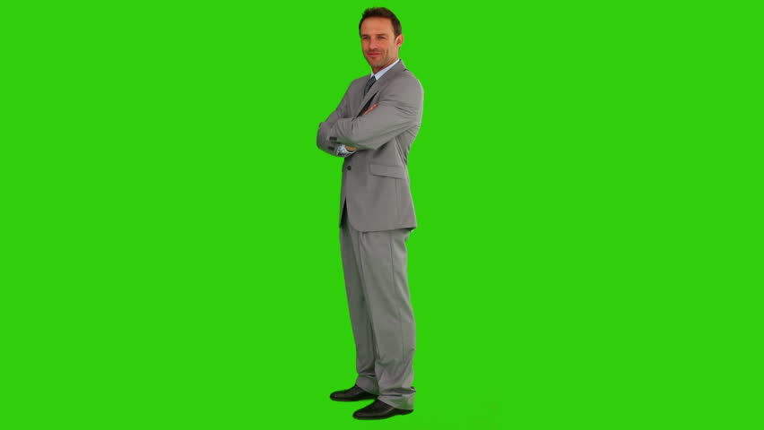 Chroma-key footage of a man in suit smiling and looking at the camera - HD stock video clip