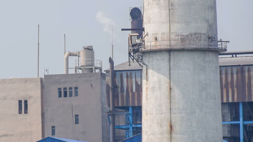 KOLKATA, WEST BENGAL / INDIA - JUNE 14TH :  Unidentified factory chimney emitting gas in air, polluting environment. India is fighting against pollution by all means. Editorial footage. - HD stock footage clip