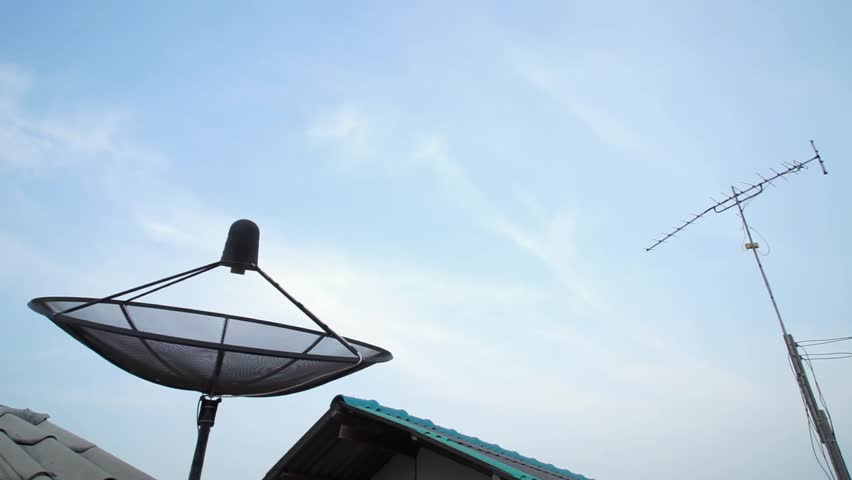 Satellite and antenna on the roof with open sky - HD stock video clip