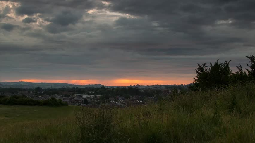 Time lapse of the Sunset over Exeter, Devon from Ludwell Valley Park - HD stock footage clip