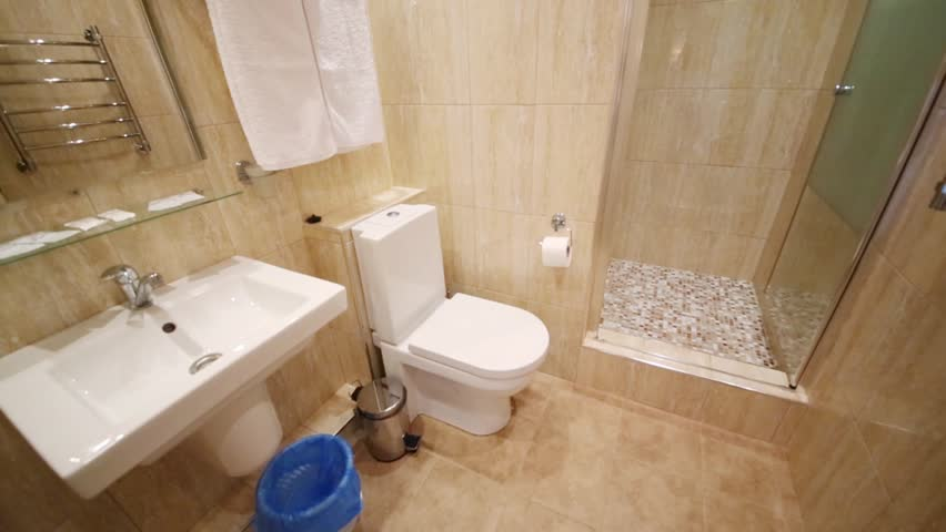 SOCHI, ADLER, RUSSIA - JULY 21, 2014: The interior of a bathroom with toilet and shower in the El Paraiso Hotel. The hotel - a modern nine-storey complex with 65 comfortable rooms