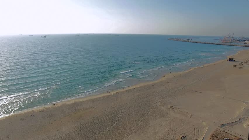 Aerial: Beautiful coastline. Sand on the beach and blue sea.  Seaside.
