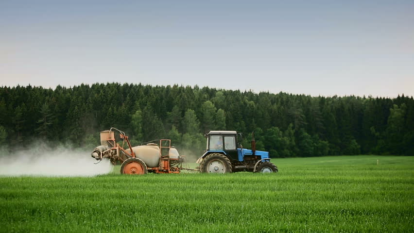Tractor In Field Planting : Tractors sprayed with fertilizer grass on the field hd