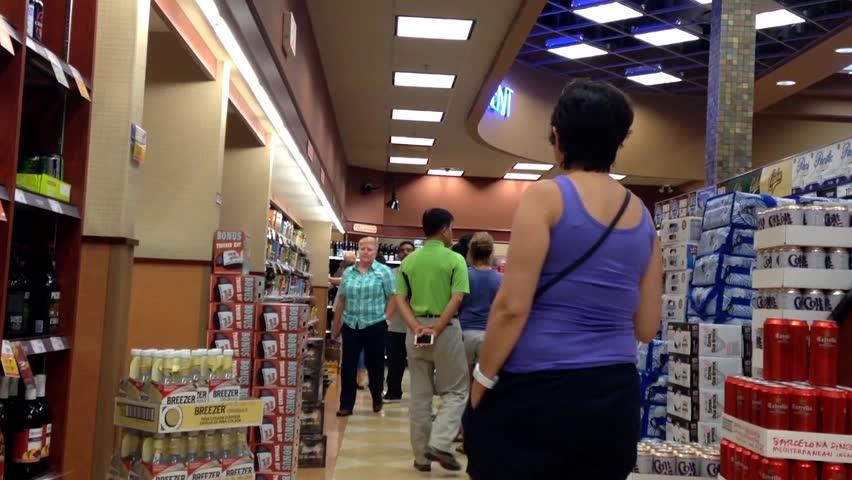 Coquitlam, BC, Canada - July 18, 2015 : Shoppers choosing wine inside BC liquor store