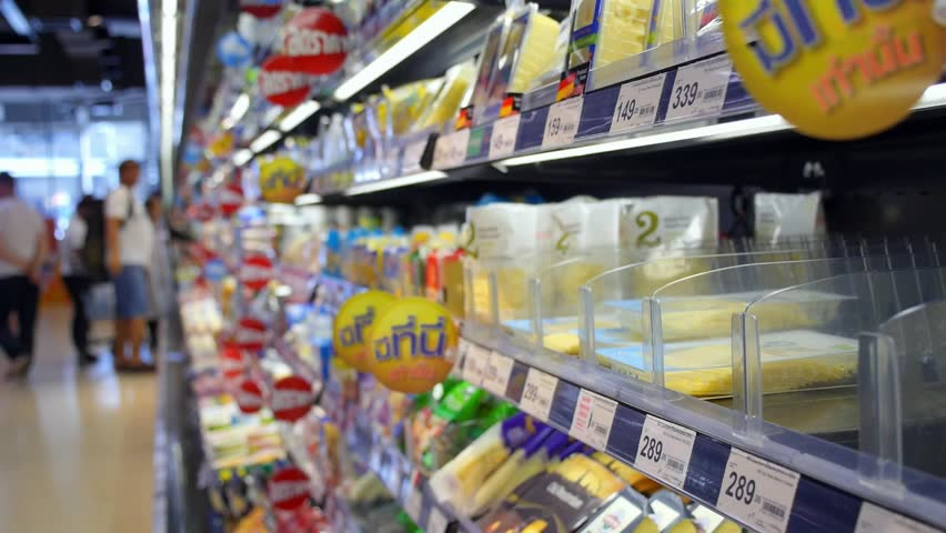 THAILAND, KOH SAMUI, 30/05/2015 - Closeup Shelf with Dairy Products in Supermarket Aisle. HD, 1920x1080.