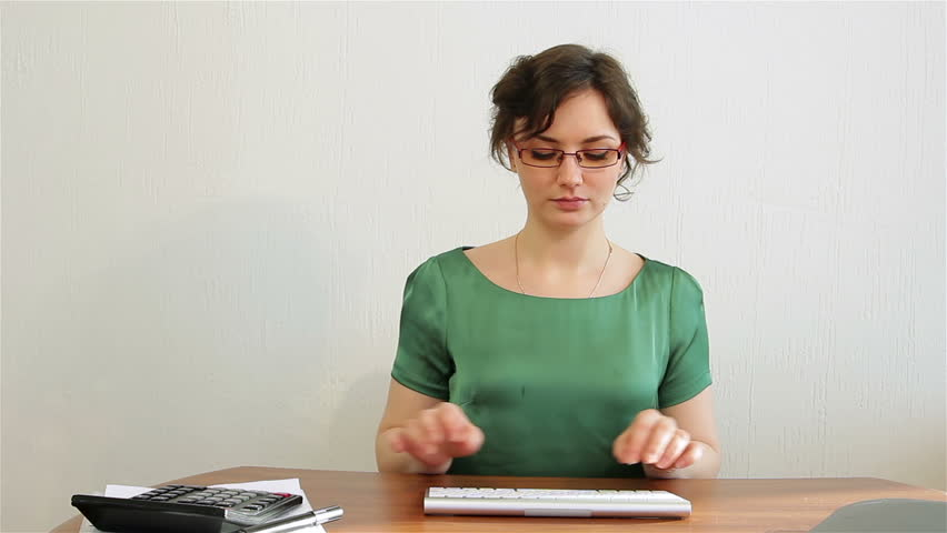 Using a Wireless Keyboard. Young woman typing on keyboard