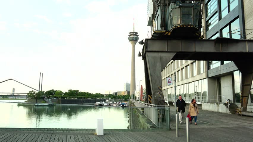 DUSSELDORF, GERMANY - May 8: Dusseldorf Harbor is home to some spectacular postmodern architecture, with contemporary status symbols signifying corporate success: Frank Gehry.,May 8, 2015,ULTRA HD 4K - 4K stock video clip