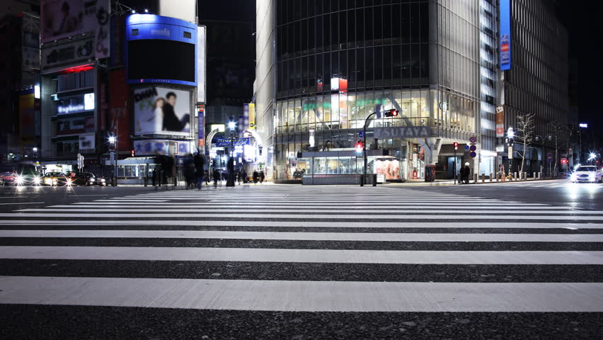 Time lapse footage of famous crosswalk at dawn in Shibuya, Tokyo, Japan