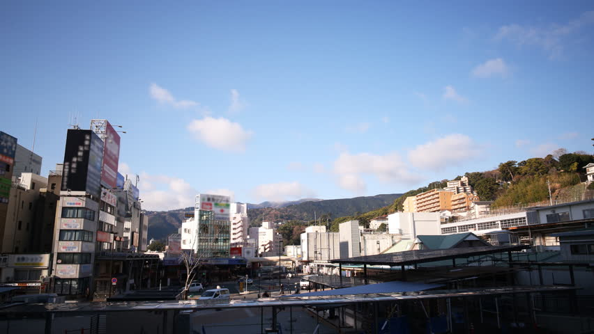 Time lapse footage of cloudscape over Atami Station in Shizuoka, Japan