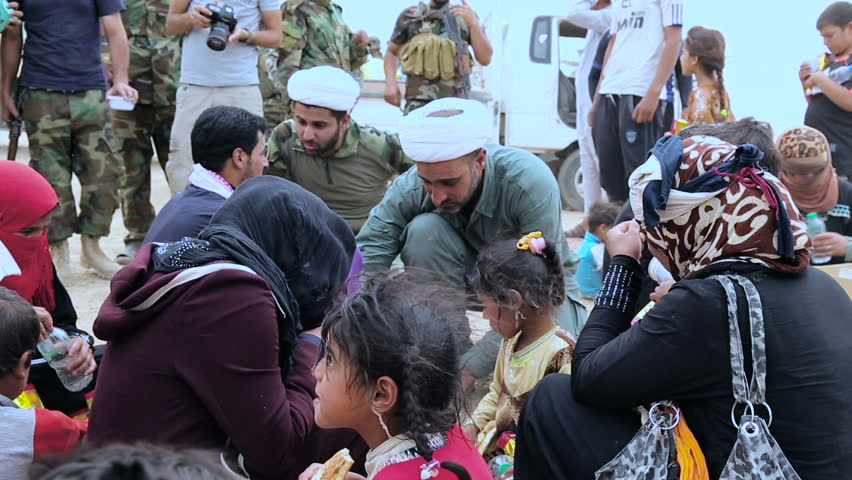 ANBAR, IRAQ - 28 MAY 2015: Iraqi army and Hezbollah Battalions distribute food and water to refugees displaced from Ramadi