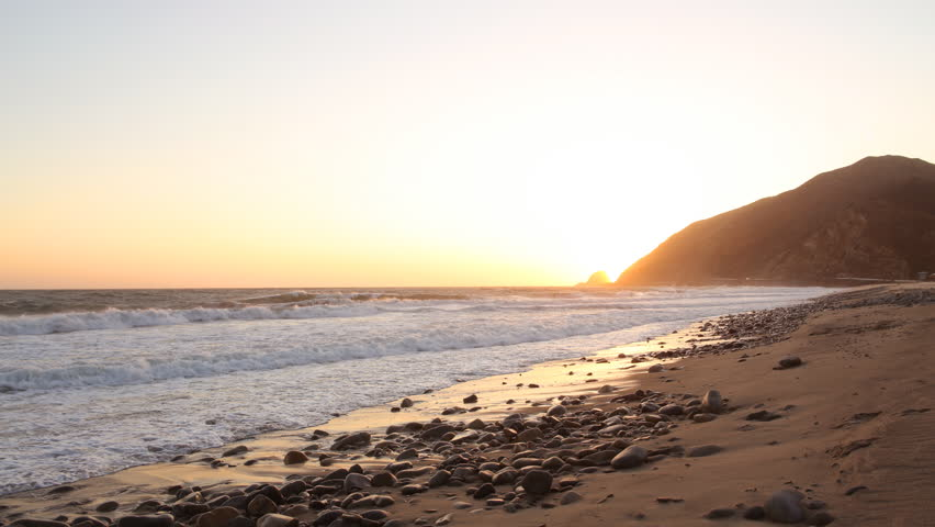 Time lapse footage with zoom in motion of coastal seascape from sunset into starry night in Malibu Beach, California