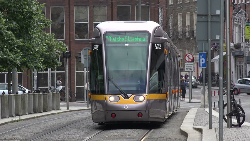 DUBLIN, LEINSTER/IRELAND - JULY 15, 2015: Dublin tram arrives at St Stephens Green. Luas is a tram light rail system which in 2014 carried 32.4 million passengers.