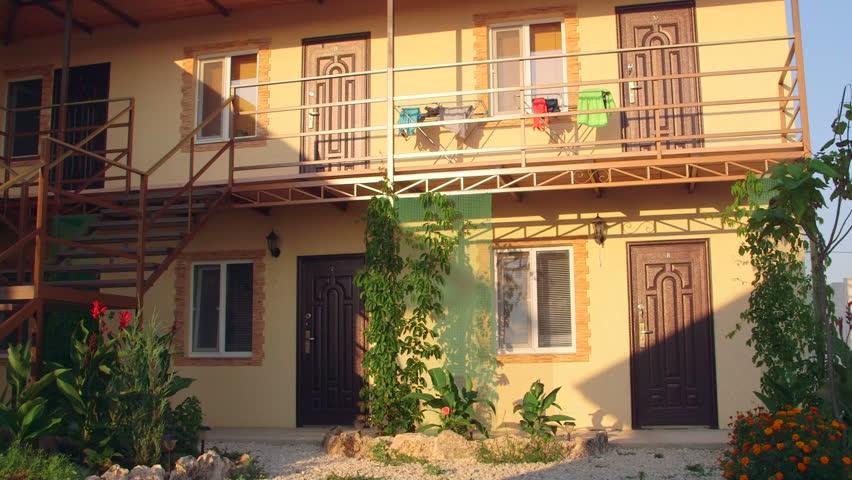 Small cheap resort hotel exterior in summer