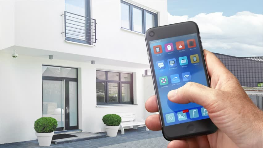 4k - Ultra HD - smart house, home automation, device with app icons. Man uses his smartphone with smarthome security app to lock the door of his house. (Shot on RED)
