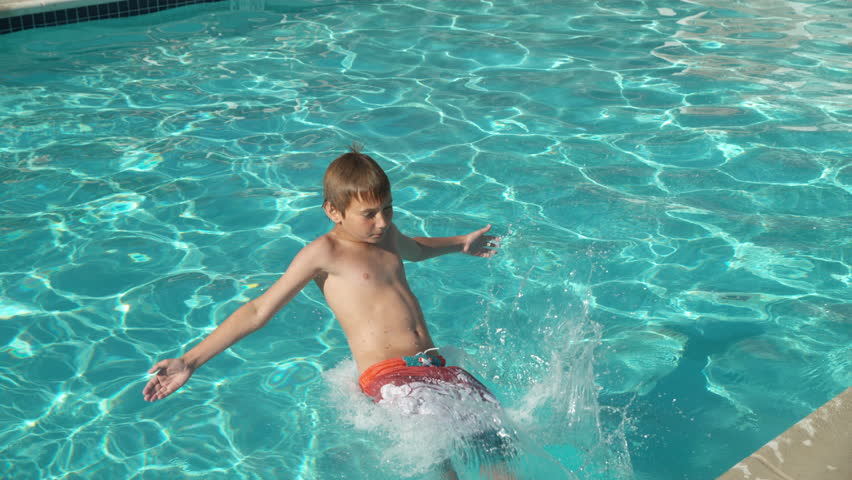 Boy splashing into pool in slow motion, shot on Phantom Flex 4K