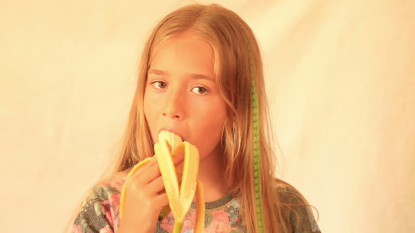 Cute girl eating banana stock footage video 11321501 for Cute teenager girls