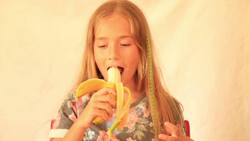 Cute girl eating banana