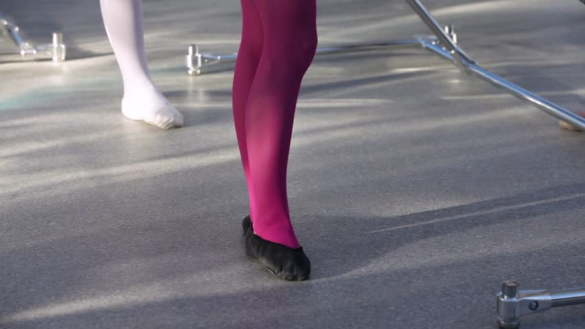 Close up of little girl ballet dancer's feet as she practices