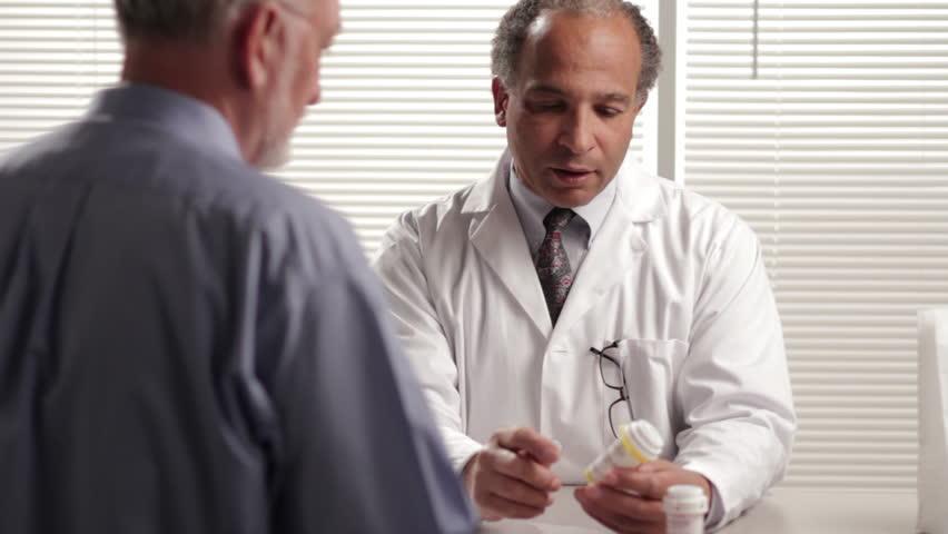 Pharmacist explaining prescription to customer, dolly shot
