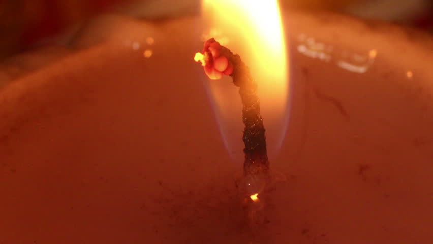 Wider Macro Close up of Burning Candle Wick & Flame (Static), with edge of candle top visible.  Nearly a minute long, with many nice variations in flame flicker and movement