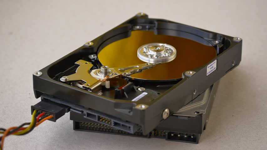 Stack of Hard Disk Drives. HDD is a data storage device used for storing and retrieving digital information using rotating platters coated with magnetic material