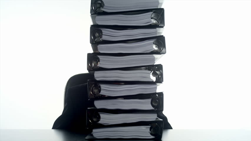 An Hispanic man behind a stack of binders   - HD stock footage clip