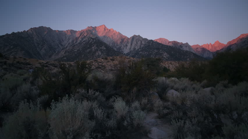 3 axis motion controlled time lapse with dolly right, tilt up & pan right motion of sunrise illuminating Mt. Whitney in Sierra Nevada Mountains in California