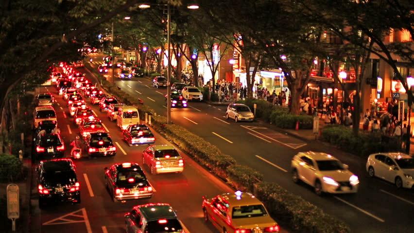 Illuminated Aoyama Street car traffic rush hour at evening. Japan, Tokyo.