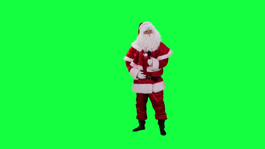 Santa Claus with microphone chroma key (green screen). Santa sings a quiet song isolated on green