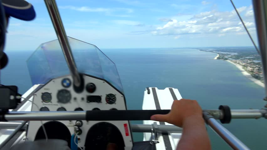 Seaplane, open cockpit flying in Florida, Gulf Coast area. - 4K stock footage clip