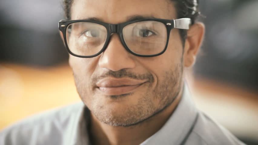 Confident smiling hispanic man looking at camera