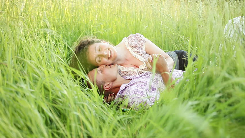Couple kissing in the grass - HD stock footage clip