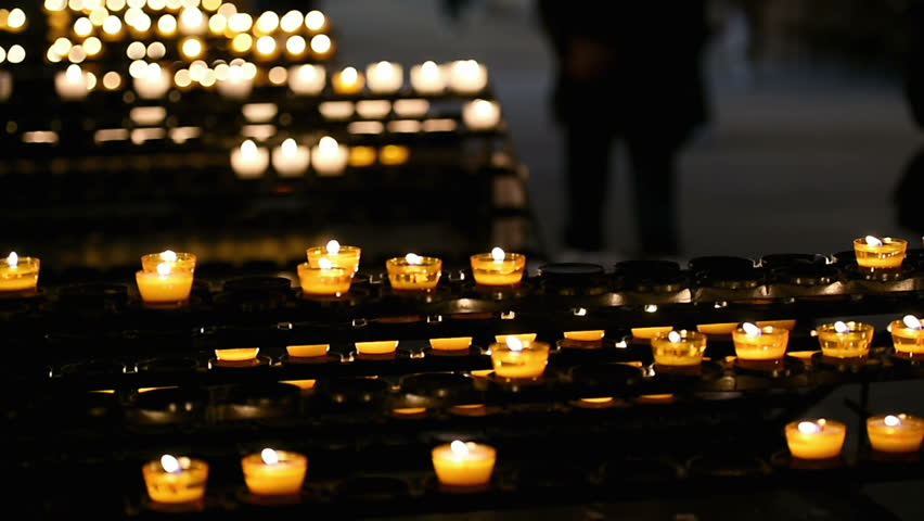 Lots of candles with shallow depth - religious theme depiction in cathedral