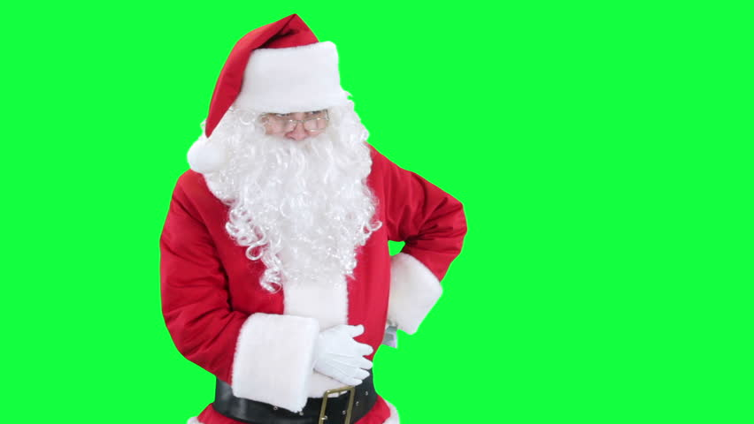 Santa Claus reading a letter chroma key (green screen). Santa Santa pulls out a piece of paper from his bosom isolated on green
