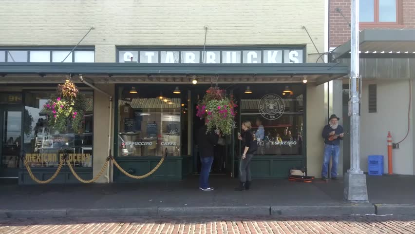 Seattle, Washington - September, 2015 - The original Starbucks at Pike Place early in the morning with few people around.